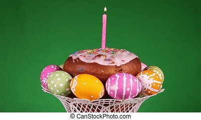 Easter cake on green background - Easter cake with burning...