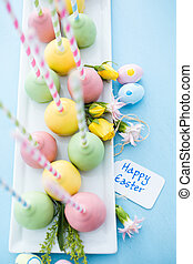 Easter cake pops on fancy fun straws.