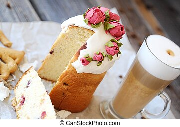 Easter cake with roses and coffee on the table