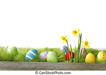 Easter card with eggs and daffodils over spring grass...