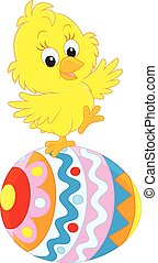 Easter chick - Little yellow chick on a colorfully painted ...