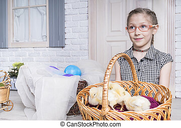 Easter chickens in the hands of child