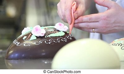 easter chocolate eggs hands pastry chef decorating