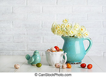 Easter chocolate eggs in the white cup