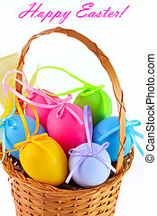 Easter colored eggs in the basket. Happy Easter!