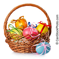 Easter colored eggs in the basket on white background