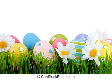 Easter colored eggs on the grass. - Easter colored eggs on ...