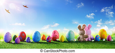 Easter - Colorful Decorated Eggs On Field With Couple Of Bunnies
