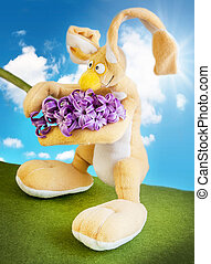toy bunny holding a flower against the sky