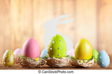 Easter composition with colorful Easter eggs and bunny.