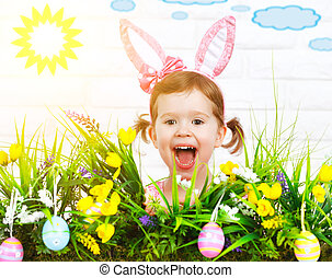 Easter concept. Happy funny child girl in  costume bunny with grass and flowers