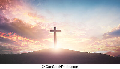 Easter concept: The cross on mountain sunset background