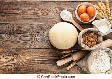 Easter concept. Wheat dough and ingredients for cooking on board.