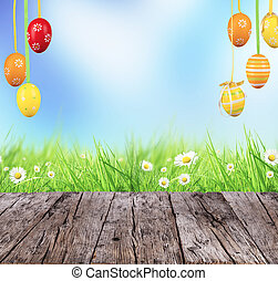 Easter concept with colored eggs and wooden planks