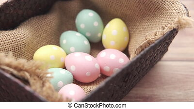 easter concept with egg on pink background..