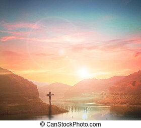 Easter concept:Silhouette cross on Calvary mountain sunset background.