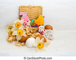 Easter cookie in a basket of flower Narcissus and chicken egg