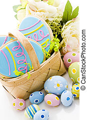 Easter cookies in shape of egg decorated with blue icing.