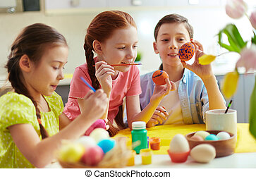 Easter craft - Photo of cute kids painting Easter eggs at...