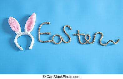 Easter creative inscription on a blue background.