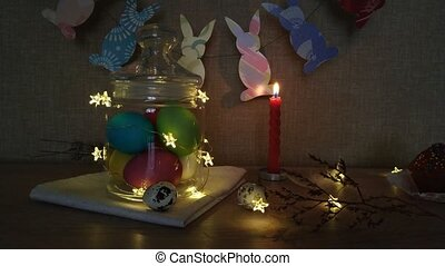 Easter decoration burning candles eggs garlands - Easter...