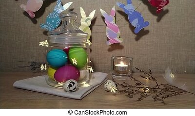Easter decoration burning candles falling feather - Easter...