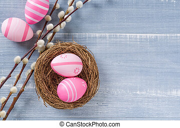 Easter decoration on a blue wooden background with copy space
