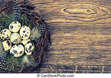 Easter decoration with birds eggs on wooden background