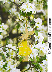 Easter decoration with bunny in the spring garden