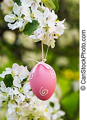 Easter decoration with egg in the spring garden