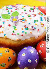 Easter decorations - eggs and cakes on the tabletop