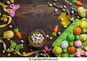 Easter decorations with colorful eggs and sweet candy over...