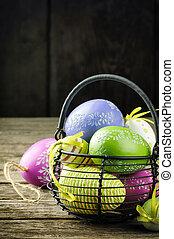 Easter decorative eggs in basket