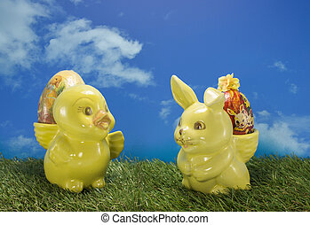 easter duck and bunny on green grass and blue sky as...