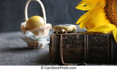 easter egg and a gold pocket watch, easter background