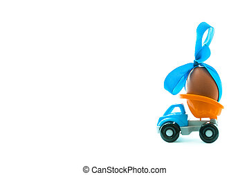 Easter egg and toy car on white background, happy easter day concept, space for text