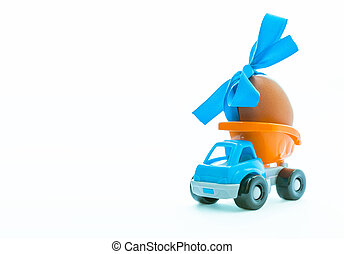 Easter egg and toy car - truck on white background, happy easter day concept, space for text