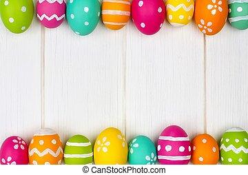 Easter egg border on white wood