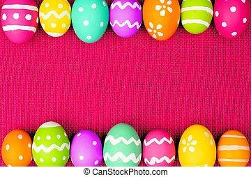 Easter egg border over pink burlap