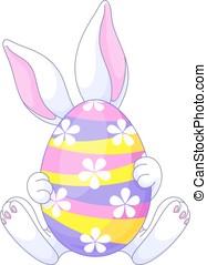 Easter Egg - Easter bunny hiding behind a huge egg