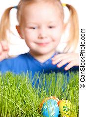Easter egg hunt - Cute little girl found Easter eggs hidden...