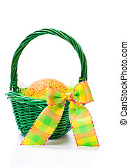 Easter egg in a basket on white background