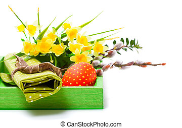 Easter egg in a basket with green cloth. on a white background.