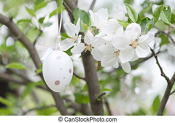 Easter egg in a cherry tree
