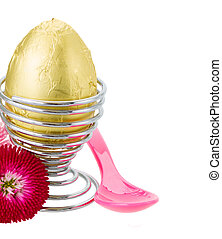 easter egg in egg holder with spoon
