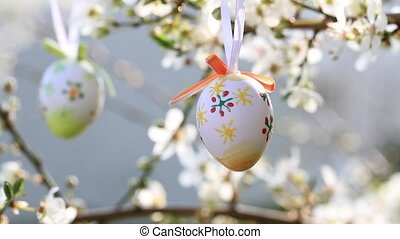 Easter egg on a flowering tree bran