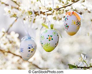 Easter egg on a flowering tree branch