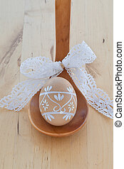 Easter egg on wooden spoon