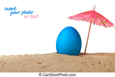 Easter egg on the beach under an umbrella
