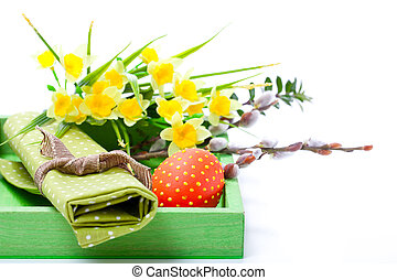Easter egg with a serviette, in a tray for breakfast. isolated on white background.
